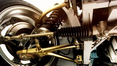 What are the different types of front suspension, and